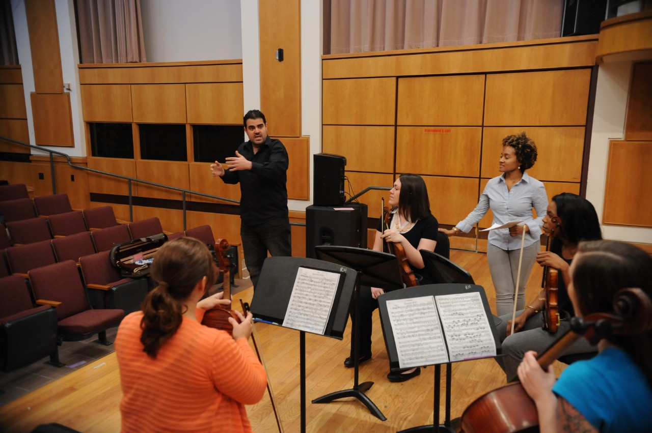 across campus a photo essay  student nicole burns members of the russell stanger string quartet listen to violist jamie amador as he critiques their