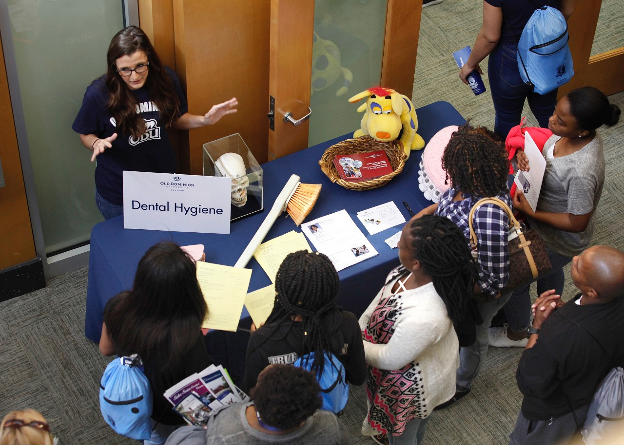across campus a photo essay 6 2017 odu senior michaela jones answers dental hygiene questions in the lobby of the college