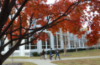 Art students walk to class during the fall season.
