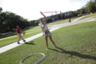 Young female hula hooping on Kaufman Mall.