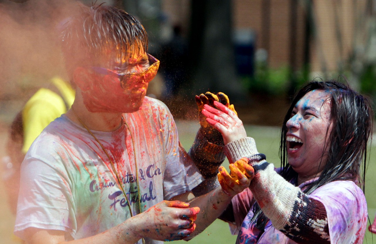 across campus a photo essay acirc  kayi chan adds orange powder to an already colorful michael cheng during the asian water and