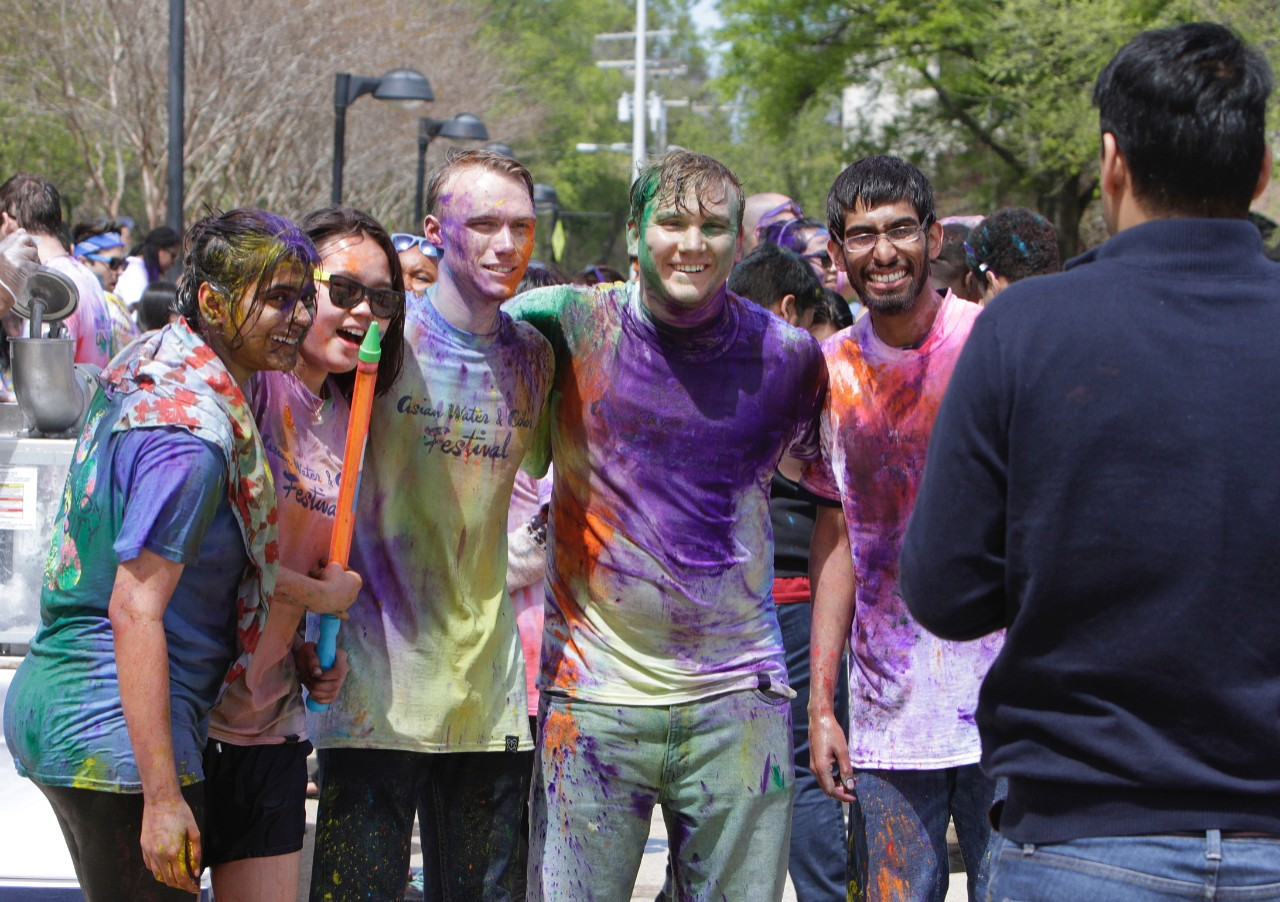 across campus a photo essay acirc  students drenched water and colorful powder pose for a picture